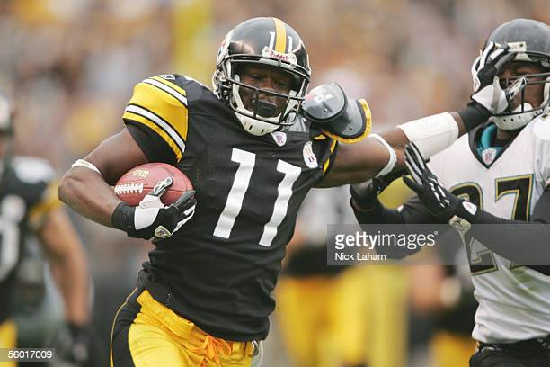 Wide receiver Quincy Morgan of the Pittsburgh Steelers stiff arms a defender against the Jacksonville Jaguars at Heinz Field on October 16 2005 in...