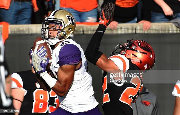 Wide receiver Quinten Pounds of the Washington Huskies catches a pass as cornerback Isaiah Dunn of the Oregon State Beavers defends during the first...