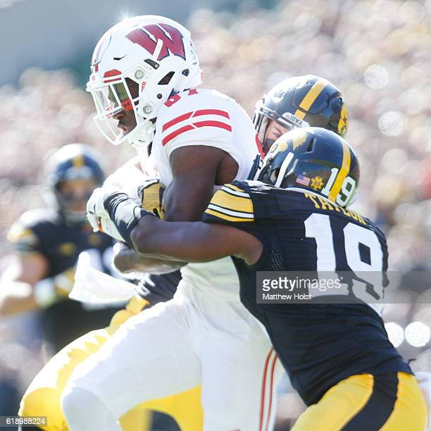 Wide receiver Quintez Cephus of the Wisconsin Badgers makes reception in the third quarter in front of defensive backs Brandon Snyder and Miles...