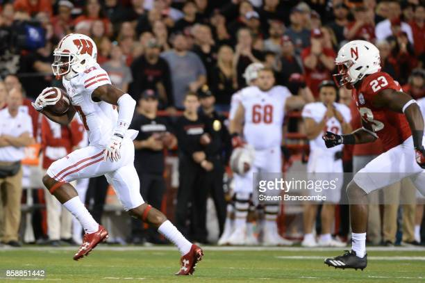 Wide receiver Quintez Cephus of the Wisconsin Badgers outruns defensive back Dicaprio Bootle of the Nebraska Cornhuskers at Memorial Stadium on...