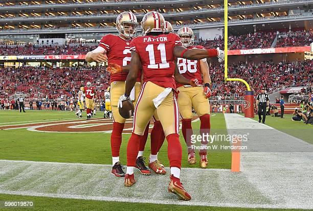 Wide receiver Quinton Patton Blaine Gabbert and Garrett Celek of the San Francisco 49ers celebrates after Patton scored a touchdown against the Green...