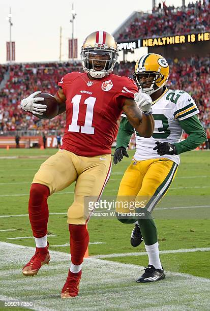 Wide receiver Quinton Patton of the San Francisco 49ers beats cornerback Damarious Randall of the Green Bay Packers to the flag scoring on a three...