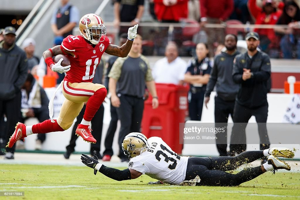 Wide receiver Quinton Patton #11 of the San Francisco 49ers breaks a tackle from free safety Jairus Byrd #31 of the New Orleans Saints during the first quarter at Levi's Stadium on November 6, 2016 in Santa Clara, California.