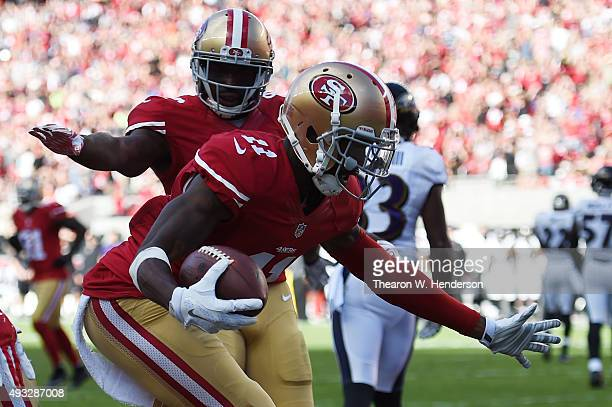 Wide receiver Quinton Patton of the San Francisco 49ers celebrates after a 21yard touchdown catch against the Baltimore Ravens during their NFL game...