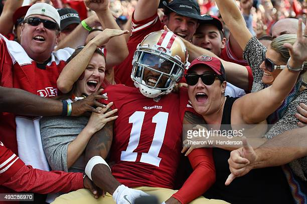Wide receiver Quinton Patton of the San Francisco 49ers celebrates in the stands after a 21yard touchdown catch against the Baltimore Ravens during...