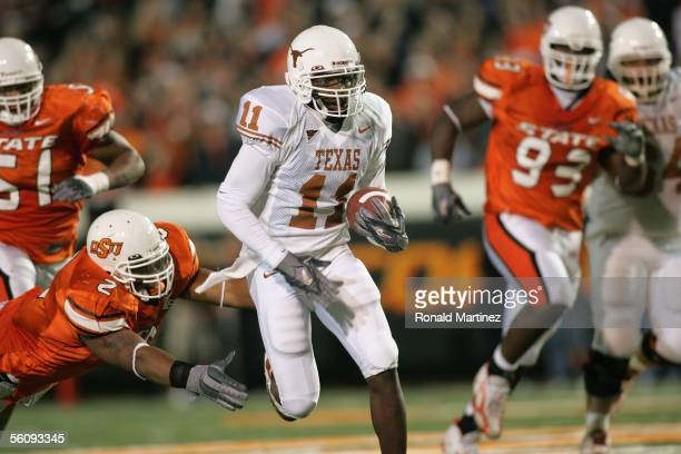 Wide receiver Ramonce Taylor of the Texas Longhorns carries the ball against the Oklahoma State Cowboys on October 29 2005 at Boone Pickens Stadium...