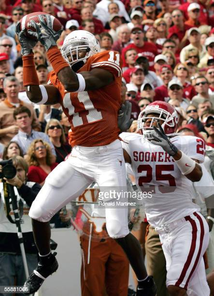 Wide receiver Ramonce Taylor of the Texas Longhorns makes a touchdown pass reception against D.J. Wolfe of the Oklahoma Sooners on October 8, 2005 at...