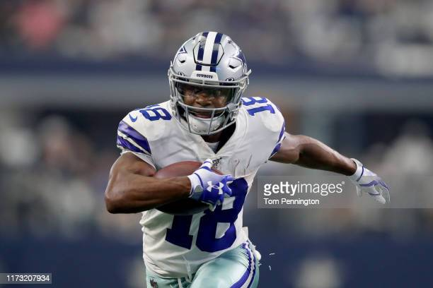 Wide receiver Randall Cobb of the Dallas Cowboys runs with the ball during the second quarter against the New York Giants in the game at ATT Stadium...
