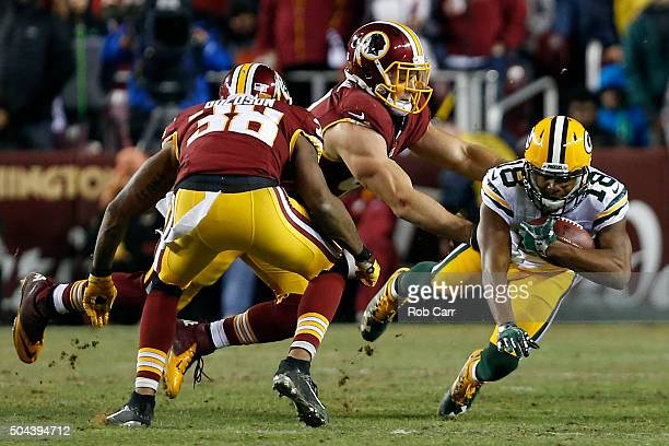 Wide receiver Randall Cobb of the Green Bay Packers carries the ball against free safety Dashon Goldson of the Washington Redskins in the third...