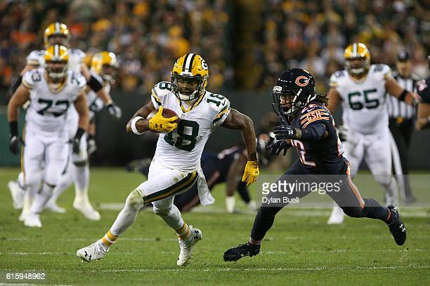 Wide receiver Randall Cobb of the Green Bay Packers carries the ball against cornerback Cre'von LeBlanc of the Chicago Bears in the third quarter at...