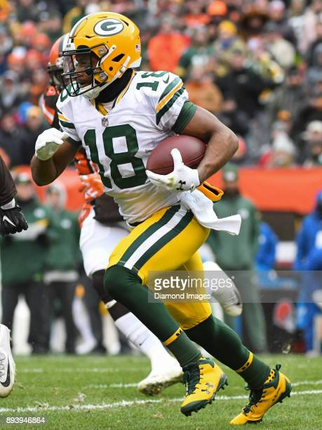 Wide receiver Randall Cobb of the Green Bay Packers carries the ball downfield in the first quarter of a game on December 10 2017 against the...