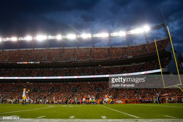 Wide receiver Randall Cobb of the Green Bay Packers catches a pass in the first quarter during a Preseason game against the Denver Broncos at Sports...