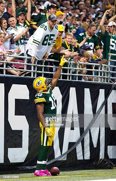 Wide receiver Randall Cobb of the Green Bay Packers celebrates after scoring a touchdown during the game against the St Louis Rams at the Edward...