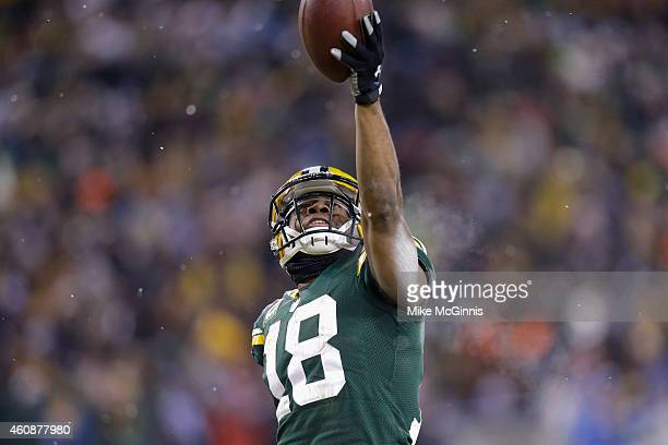 Wide receiver Randall Cobb of the Green Bay Packers celebrates after scoring in the third quarter for his second touchdown against the Detroit Lions...