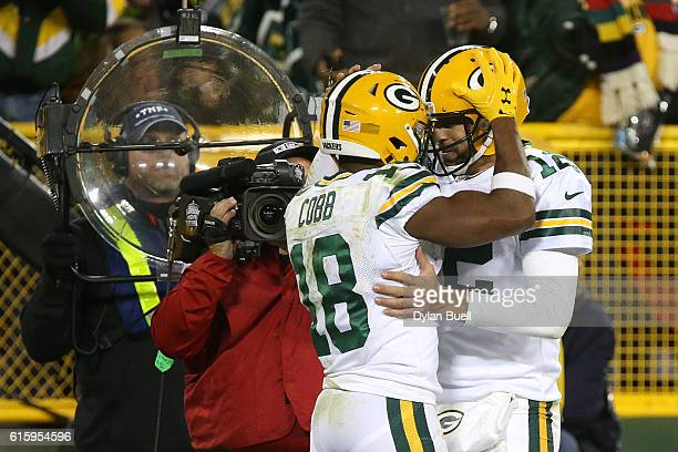 Wide receiver Randall Cobb of the Green Bay Packers celebrates with teammate quarterback Aaron Rodgers after scoring a fourth quarter touchdown...
