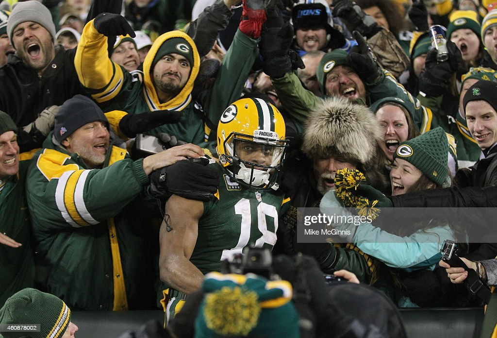 Wide receiver Randall Cobb #18 of the Green Bay Packers leaps into the crowd after scoring in the third quarter for his second touchdown against the Detroit Lions during the NFL game at Lambeau Field on December 28, 2014 in Green Bay, Wisconsin.