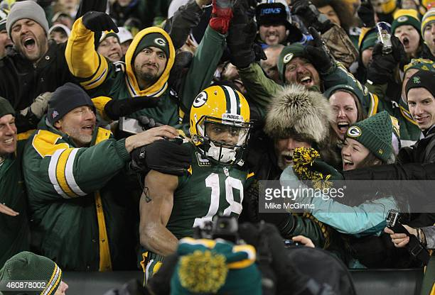 Wide receiver Randall Cobb of the Green Bay Packers leaps into the crowd after scoring in the third quarter for his second touchdown against the...