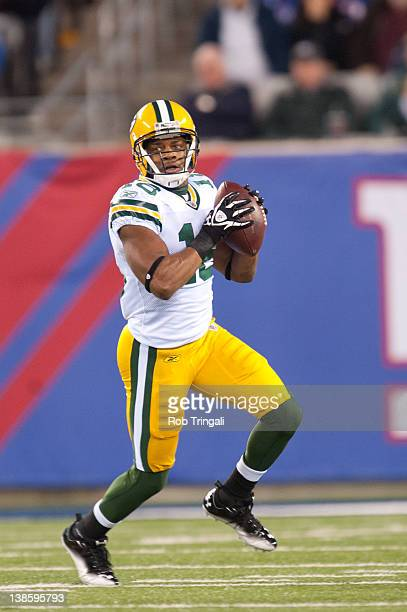 Wide receiver Randall Cobb of the Green Bay Packers ruins with the ball during the game against the New York Giants at MetLife Stadium on December 4...
