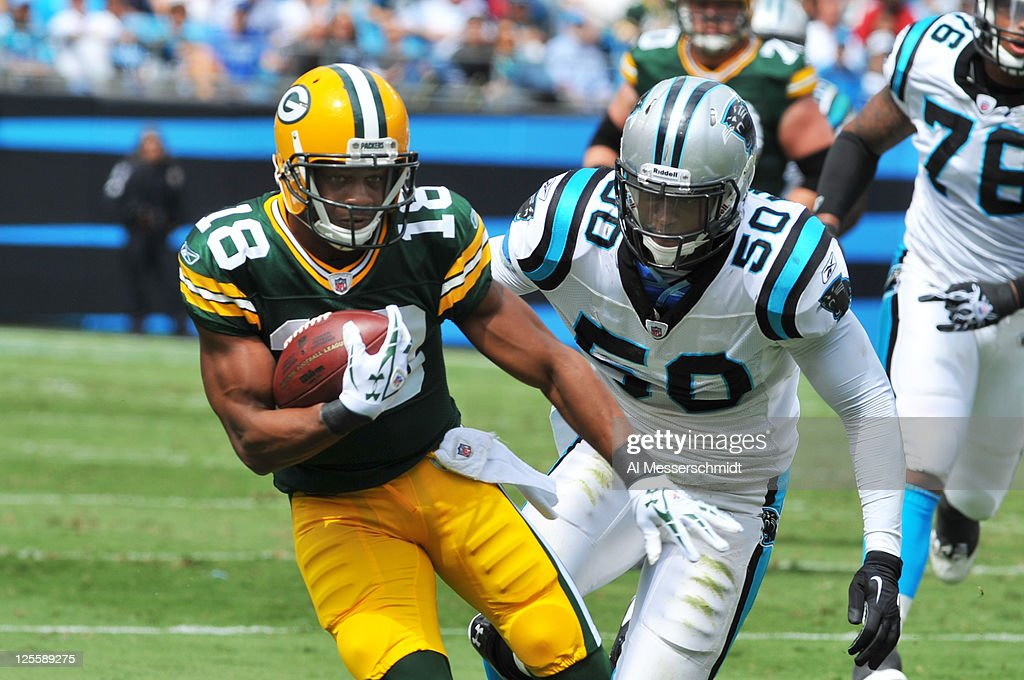 Wide receiver Randall Cobb #18 of the Green Bay Packers runs away from linebacker James Anderson #50 of the Carolina Panthers September 18, 2011 at Bank of America Stadium in Charlotte, North Carolina.