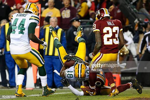 Wide receiver Randall Cobb of the Green Bay Packers scores a second quarter touchdown over cornerback Will Blackmon of the Washington Redskins during...