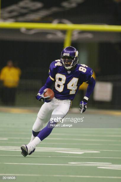 Wide receiver Randy Moss of the Minnesota Vikings carries the ball against the New Orleans Saints during the NFL game at the Louisiana Superdome on...