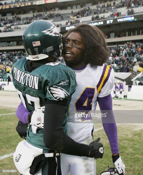 Wide receiver Randy Moss of the Minnesota Vikings congratulates Todd Pinkston of the Philadelphia Eagles in his team's victory in an NFC divisional...