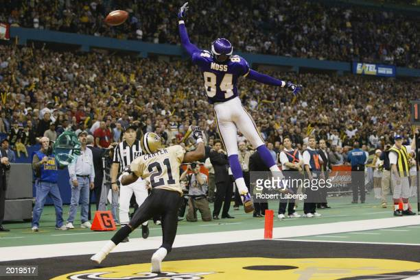 Wide receiver Randy Moss of the Minnesota Vikings just misses the football in the fourth quarter during the NFL game against the New Orleans Saints...