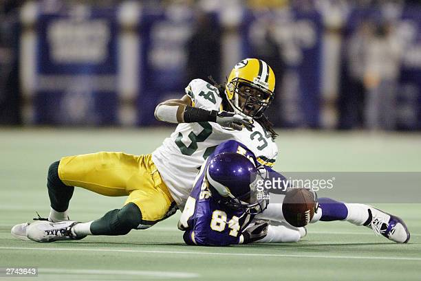 Wide receiver Randy Moss of the Minnesota Vikings makes a catch against cornerback Mike McKenzie of the Green Bay Packers during the game at the...