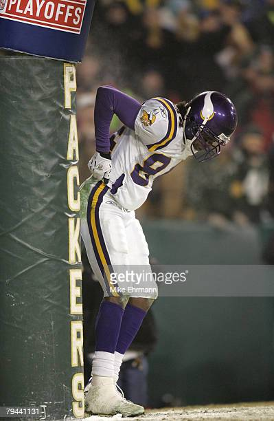 Wide Receiver Randy Moss of the Minnesota Vikings makes a mooning gesture after catching a touchdown pass during the first round playoff game against...