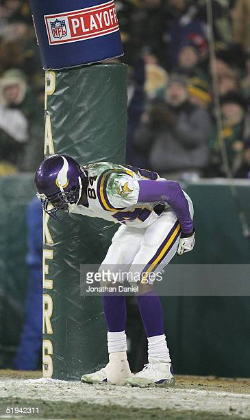Wide receiver Randy Moss of the Minnesota Vikings pretends to moon the crowd after scoring a touchdown against the Green Bay Packers in the NFC...