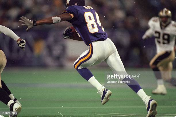 Wide receiver Randy Moss of the Minnesota Vikings races upfield against the New Orleans Saints in the 2000 NFC Divisional Playoff Game at the...