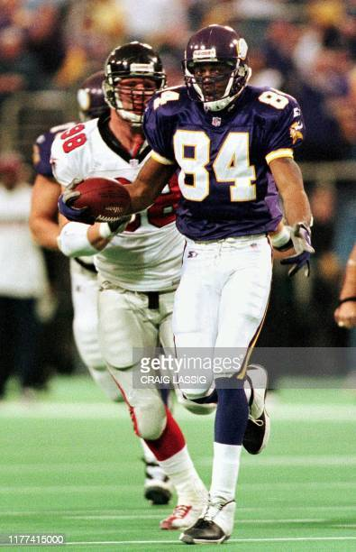 Wide receiver Randy Moss of the Minnesota Vikings runs with the ball after a reception in first half action against the Atlanta Falcons in their NFC...
