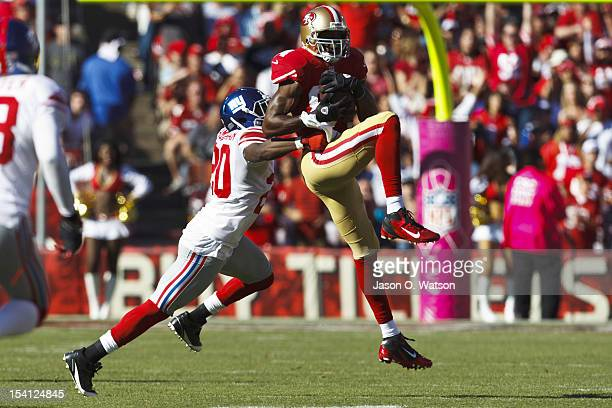 Wide receiver Randy Moss of the San Francisco 49ers catches a pass in front of cornerback Prince Amukamara of the New York Giants during the third...
