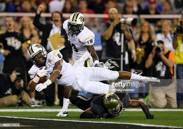 Wide receiver Rannell Hall of the UCF Knights scores a touchdown in the second quarter against the Baylor Bears during the Tostitos Fiesta Bowl at...