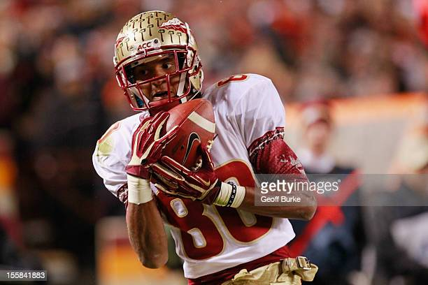 Wide receiver Rashad Greene of the Florida State Seminoles catches the ball for a touchdown against the Virginia Tech Hokies at Lane Stadium on...