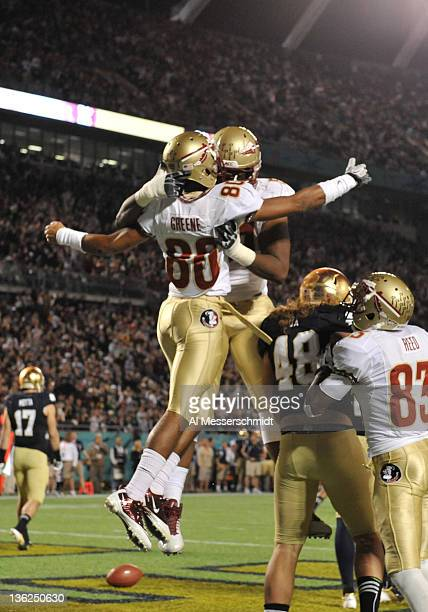 Wide receiver Rashad Greene of the Florida State Seminoles celebrates a touchdown catch against the Notre Dame Fight Irish December 29 2011 at the...