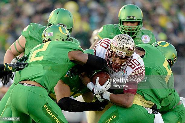 Wide receiver Rashad Greene of the Florida State Seminoles is tackled by the Oregon Ducks in the third quarter during the College Football Playoff...