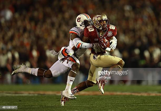 Wide receiver Rashad Greene of the Florida State Seminoles is tackled after a catch against the Auburn Tigers during the 2014 Vizio BCS National...