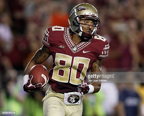 Wide Receiver Rashad Greene of the Florida State Seminoles on a pass play during the game against the Clemson Tigers at Doak Campbell Stadium on...