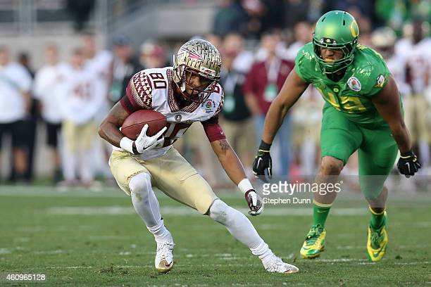 Wide receiver Rashad Greene of the Florida State Seminoles runs with the ball after a catch during the College Football Playoff Semifinal against the...