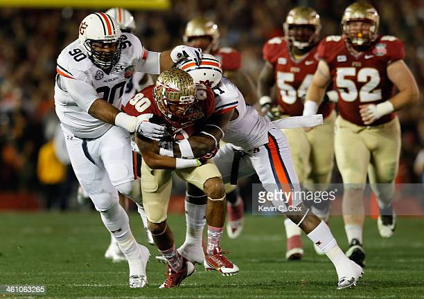 Wide receiver Rashad Greene of the Florida State Seminoles runs with the ball after a catch during the 2014 Vizio BCS National Championship Game...