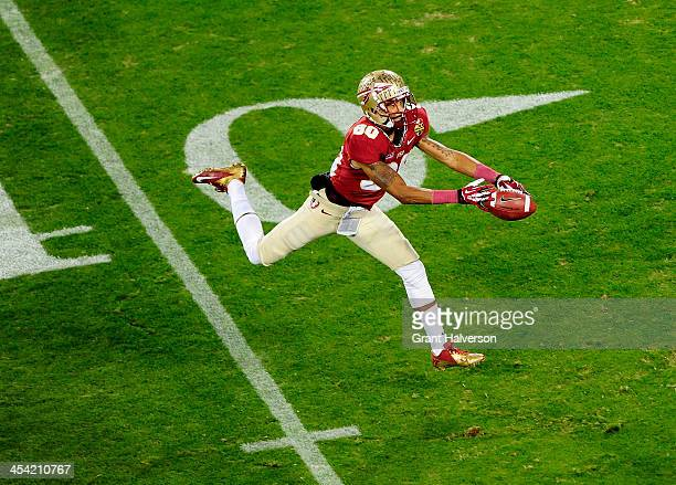 Wide receiver Rashad Greene of the Florida State Seminoles tries to make a catch against the Duke Blue Devils during the ACC Championship game at...