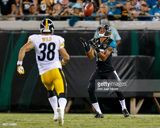 Wide Receiver Rashad Greene of the Jacksonville Jaguars on a punt return over Safety Ian Wild of the Pittsburgh Steelers during a preseason game at...