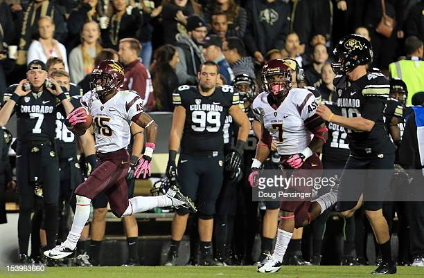Wide receiver Rashad Ross of the Arizona State Sun Devils returns the kick off opening the second half 100 yards for a touchdown as linebacker Carlos...