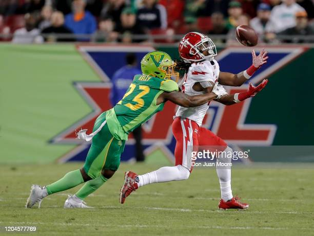 Wide Receiver Rashad Ross of the DC Defenders make a catch across the middle of the field over Anthoula Kelly of the Tampa Bay Vipers during the XFL...
