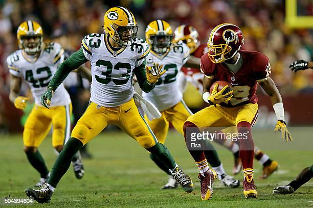 Wide receiver Rashad Ross of the Washington Redskins carries the ball against strong safety Micah Hyde of the Green Bay Packers in the third quarter...