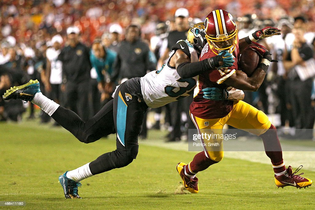 Wide receiver Rashad Ross #19 of the Washington Redskins eludes cornerback Demetrius McCray #35 of the Jacksonville Jaguars in the second half at FedExField on September 3, 2015 in Landover, Maryland.