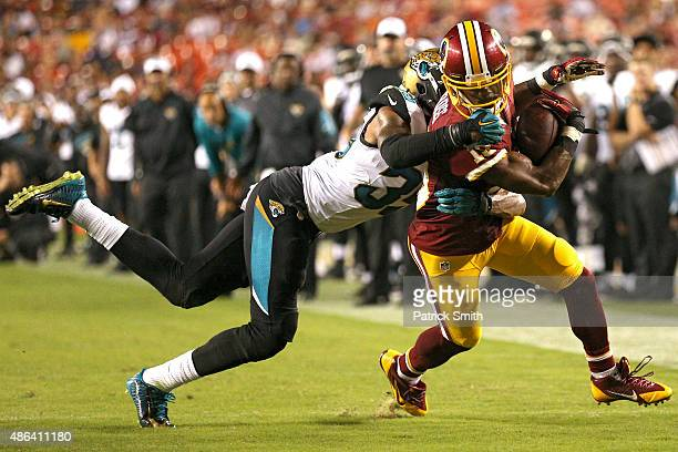 Wide receiver Rashad Ross of the Washington Redskins eludes cornerback Demetrius McCray of the Jacksonville Jaguars in the second half at FedExField...