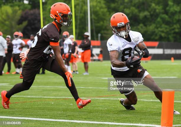 Wide receiver Rashard Higgins of the Cleveland Browns dives toward the pylon against cornerback Greedy Williams during a mandatory mini camp practice...