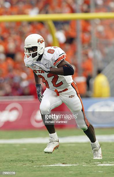 Wide receiver Rashaun Woods of the Oklahoma State Cowboys runs his route against the Mississippi Rebels during the SBC Cotton Bowl on January 2 2004...